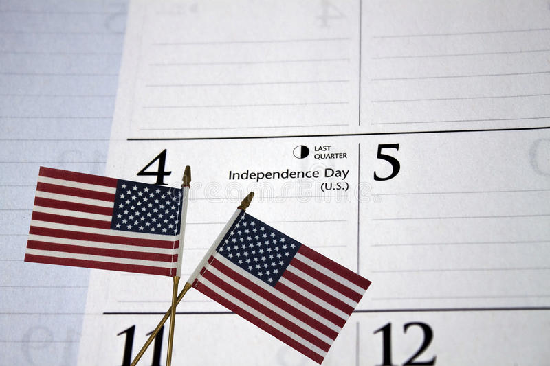 4th of July Calendar. July 4th Calendar with US flags cross for celebrating the holiday stock images