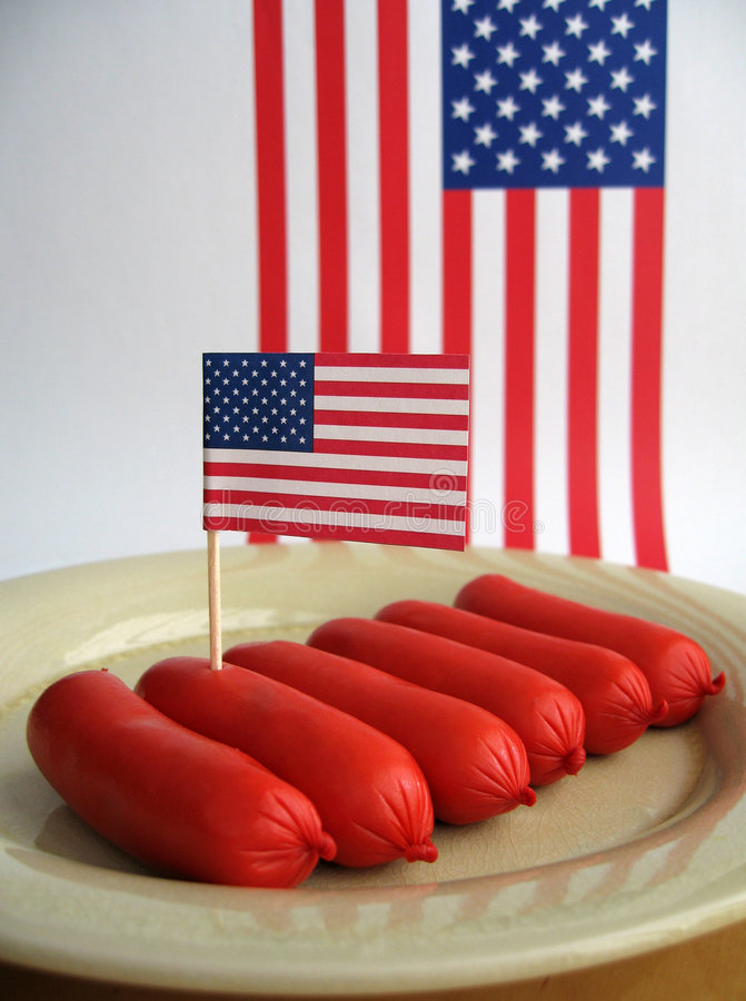 4th July Sausages. Red hot dog sausages for 4th July stock image