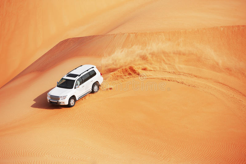 4x4 dune bashing is a popular sport of the Arabian. 4 by 4 dune bashing is a popular sport of the Arabian desert stock photography