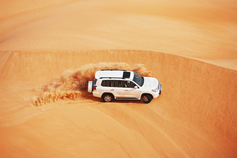 4x4 dune bashing is a popular sport of the Arabian. 4 by 4 dune bashing is a popular sport of the Arabian desert royalty free stock photo