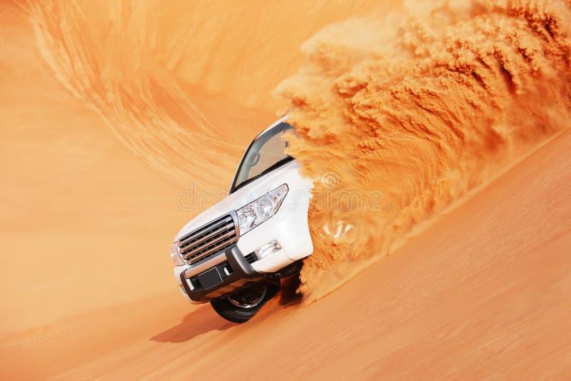 4x4 dune bashing is a popular sport of the Arabian. 4 by 4 dune bashing is a popular sport of the Arabian desert stock photo