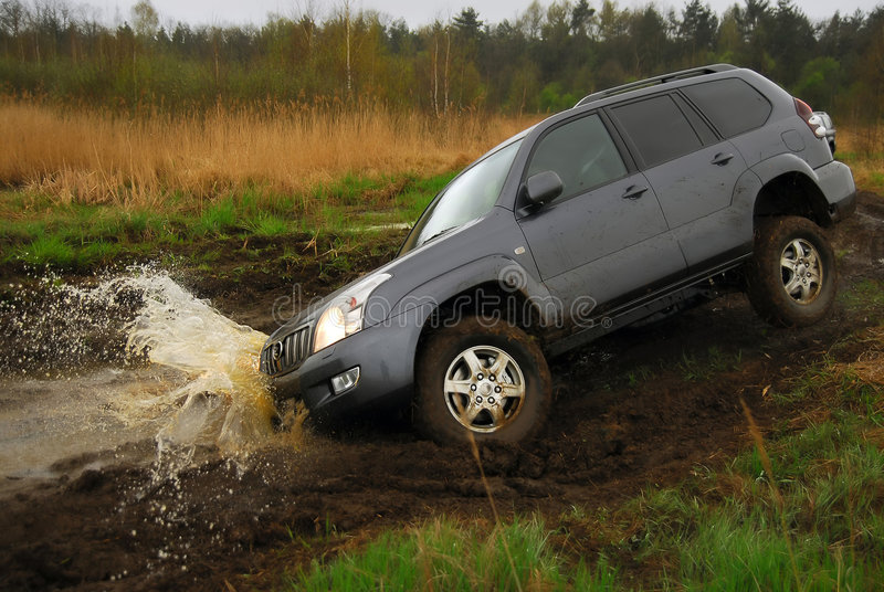 4x4 extreme sport. 4x4 car just jump into the puddle. Water splash. Extreme sport royalty free stock images