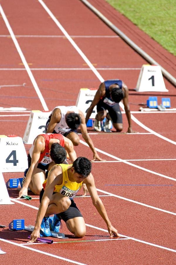 4x400 de los hombres mide la raza foto de archivo