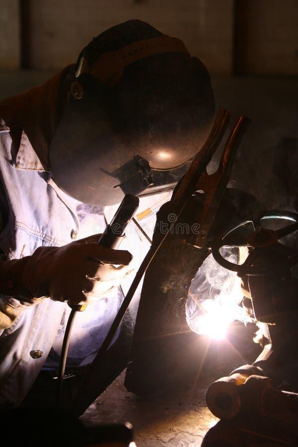 5位焊工工作 库存图片