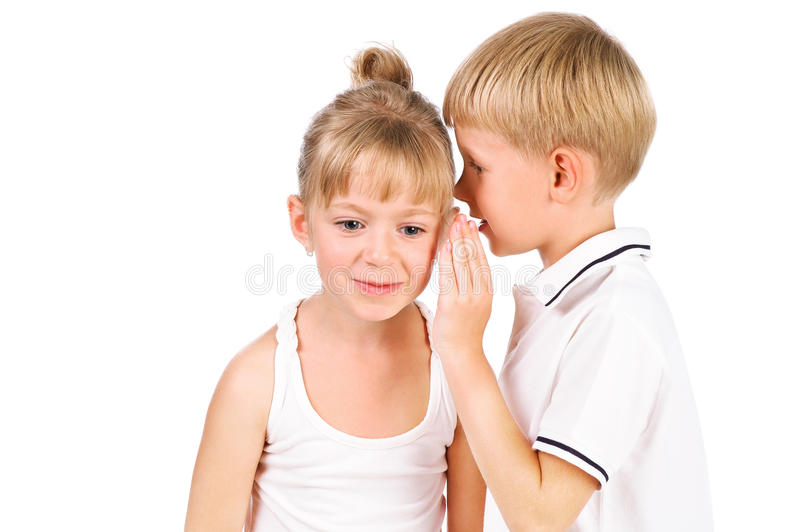 Download 5-7 Years Old Boy Whispering To Girl Stock Photo - Image: 26706078