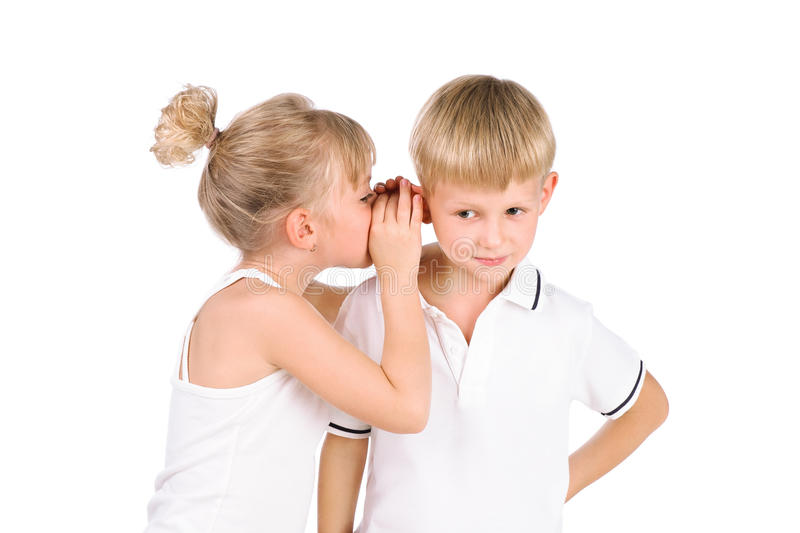 5-7 Years Old Girl Whispering To  Boy Royalty Free Stock Image