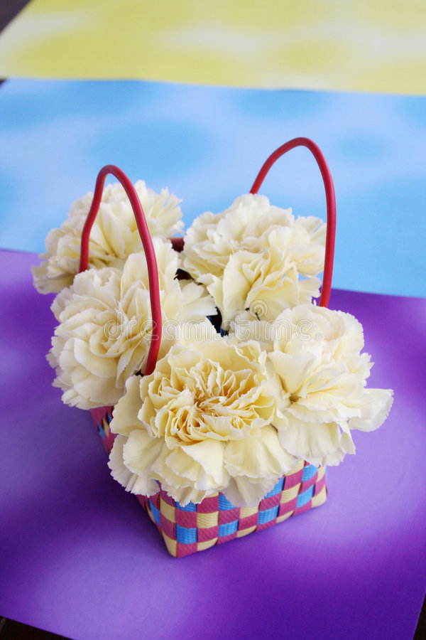 5 Carnations in the basket stock photo