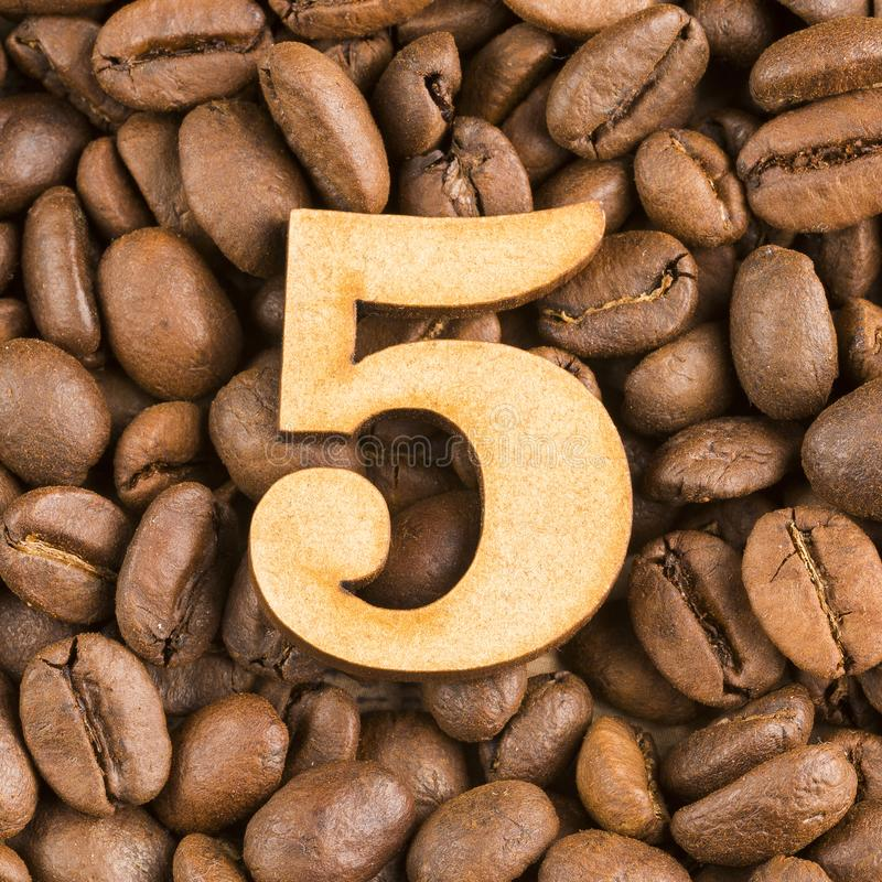 Free 5, Number On Wood- Background Of Coffee Beans Stock Photos - 135055393