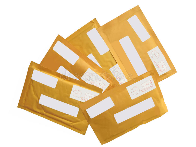 5 yellow mail packages (envelopes),recycling paper. Heap of many transit mail envelopes with empty label from recycling paper isolated on white background. paper stock photography