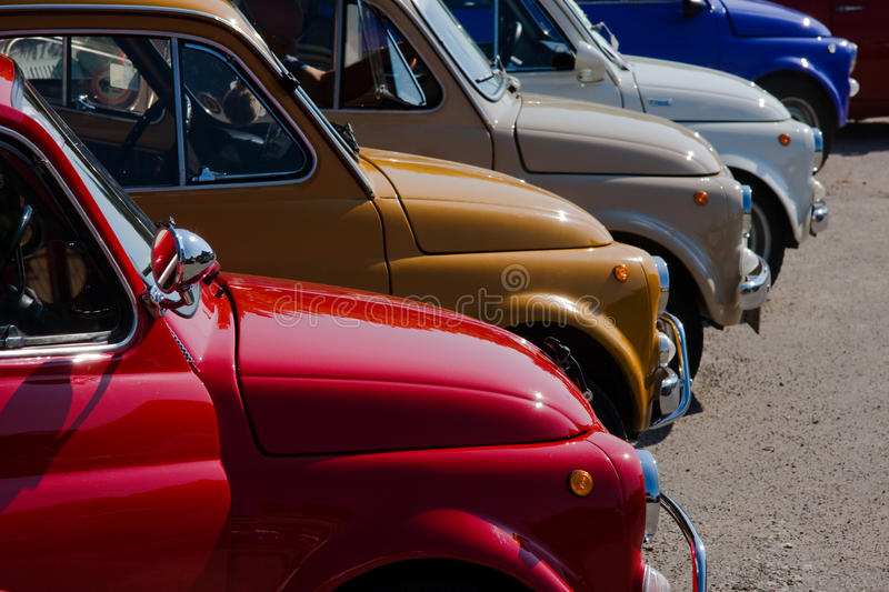 500 colors. Old fiat 500 creates a rainbow of colors stock photos