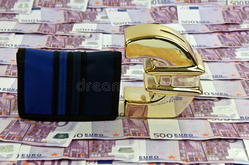 500 euro bills and gold symbol with wallet. Photo of 500 euro bills and gold symbol with wallet royalty free stock images