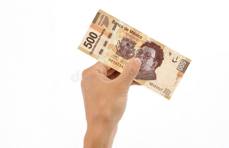 500 pesos för billhandholding royaltyfria bilder