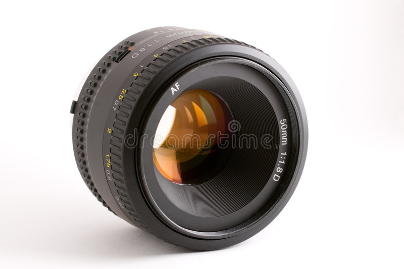 50mm auto-focus camera lens. A black 50mm prime auto-focus camera lens for a modern SLR camera, set against a white background. The lens has white and yellow stock image