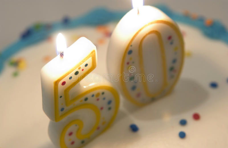 50th birthday cake. Close up of 50th birthday cake candles stock images