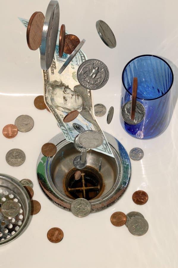 6 вниз стекают деньги стоковая фотография