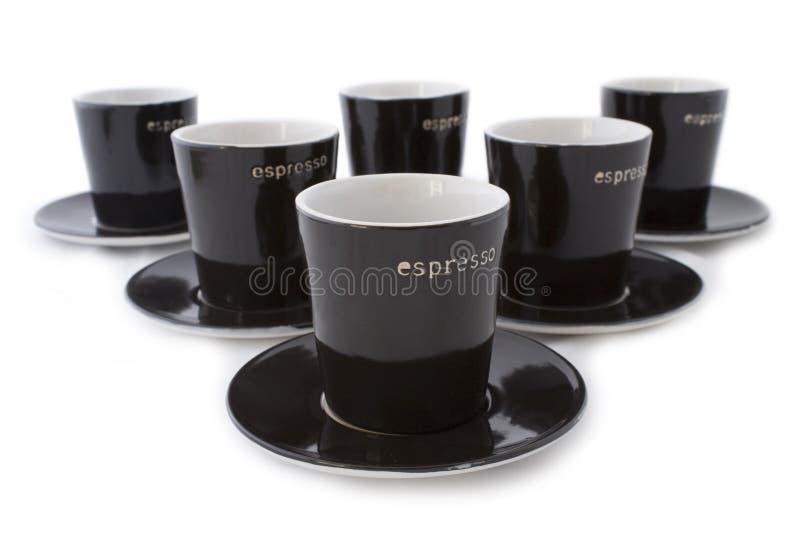 6 cuvettes de café express image stock
