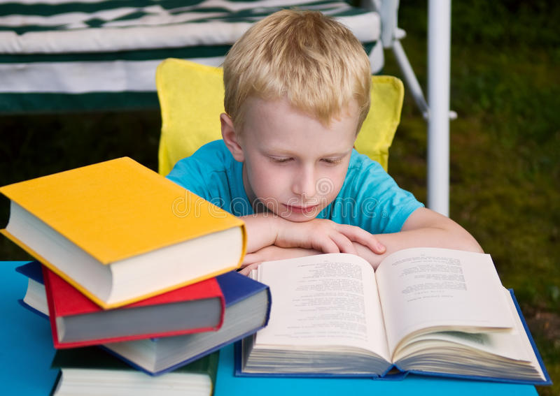 6-year Boy Reading Book Royalty Free Stock Image