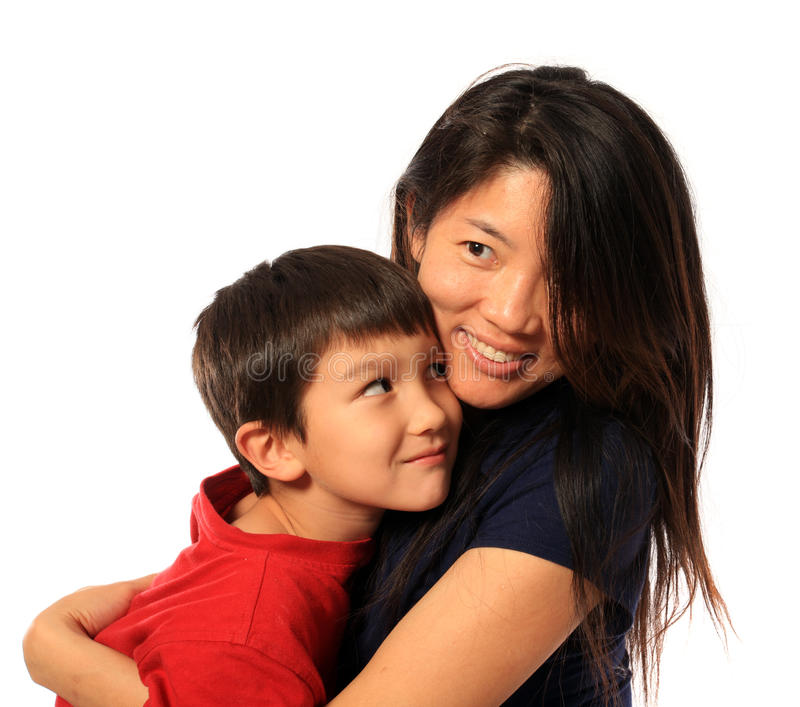 6 Years old hugging mom royalty free stock image
