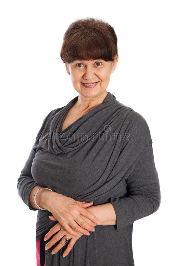 Free 65 Years Old Woman Portrait Against Of White Background. Pension Age Good Looking Woman Smiling, London Stock Photos - 64938183
