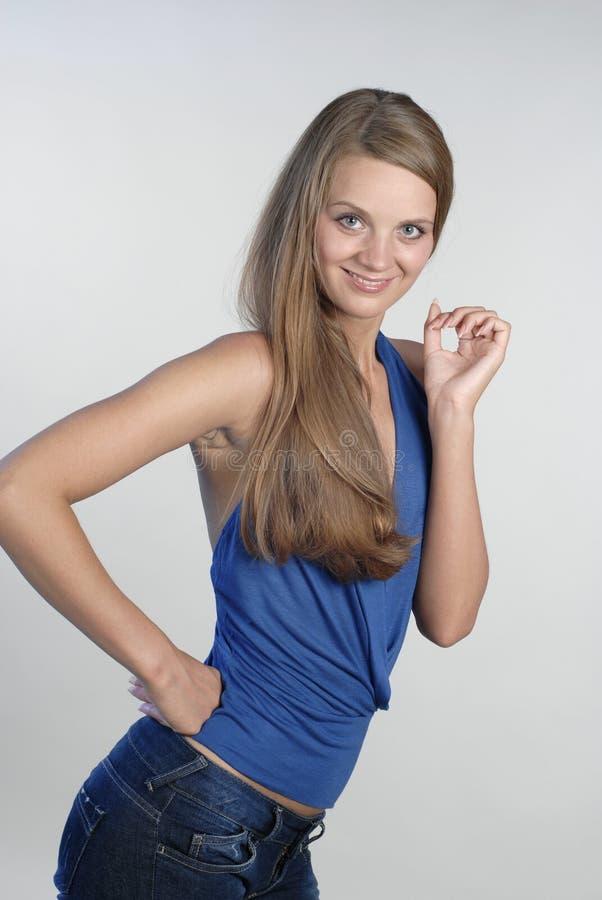 7个蓝色微笑的妇女年轻人 图库摄影