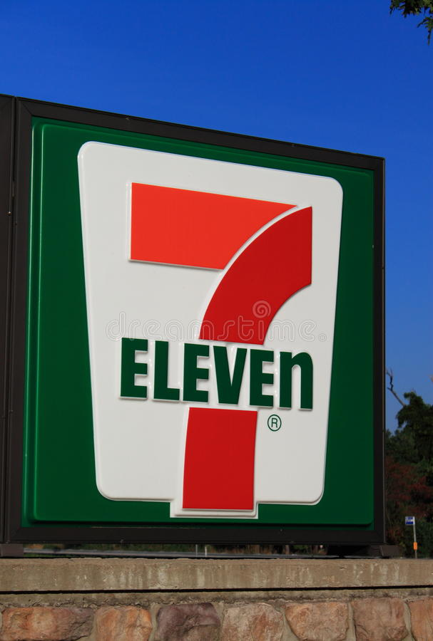 7 Eleven Logo. 7 eleven log on blue sky background stock photo