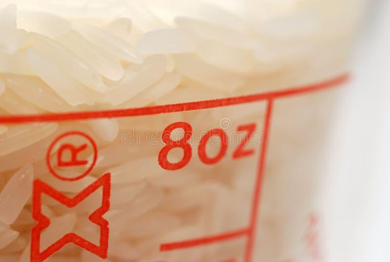 8个杯子盎司米 免版税库存图片