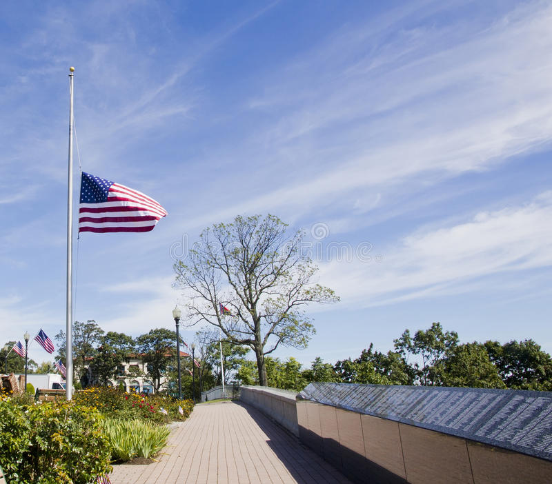 9/11 Memorial Park. American flag flies at half staff at the 9/11 Memorial Park in West Orange,NJ royalty free stock photos