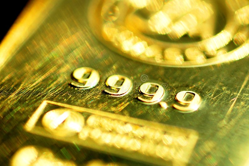 999.9 pure gold. A close up on a pure brick of gold with the markings of 999.9 royalty free stock image