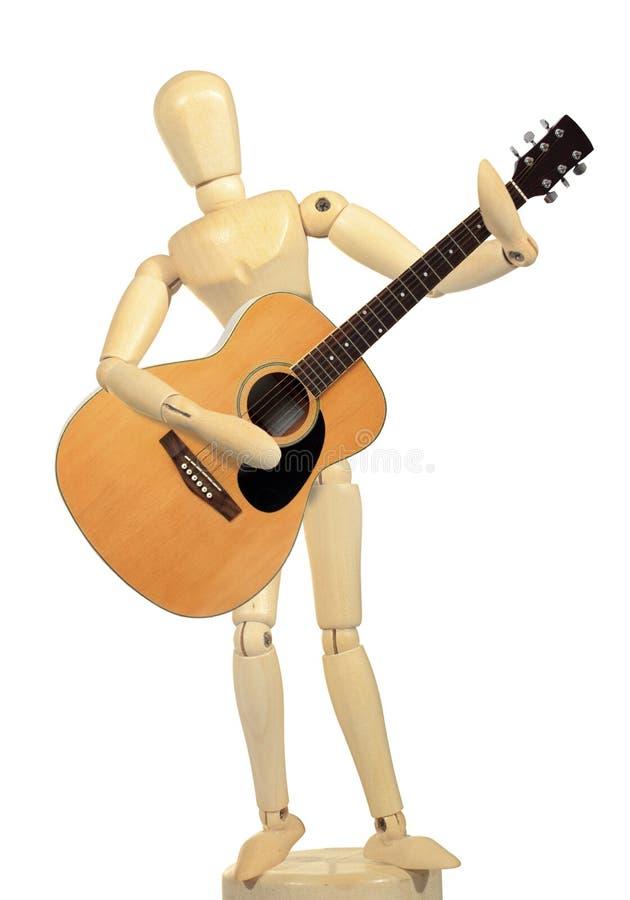 Ação de madeira amarela da guitarra do jogo do manequim fotografia de stock royalty free