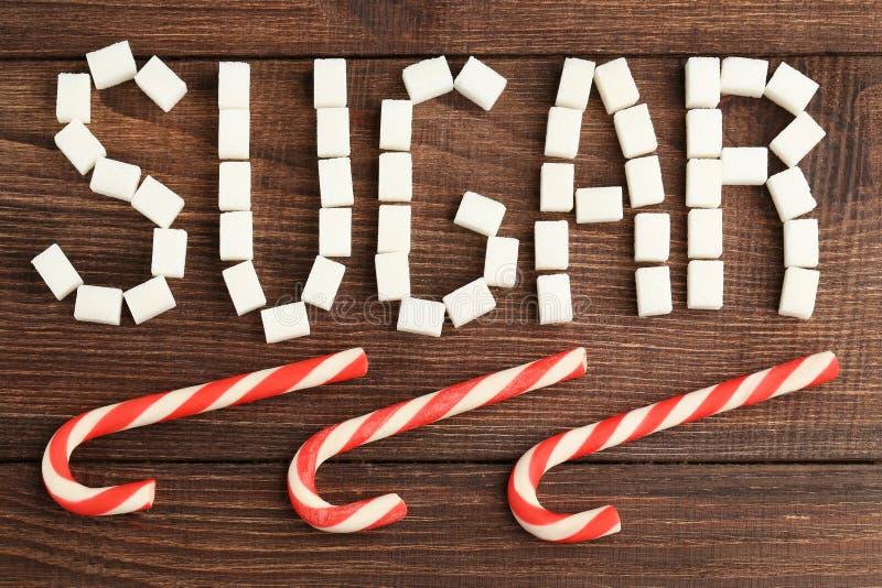 Açúcar da inscrição por cubos do açúcar fotografia de stock royalty free