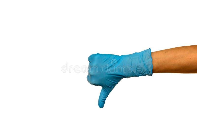 Aísle la mano de la mujer en un guante de goma azul en un fondo blanco fotos de archivo libres de regalías
