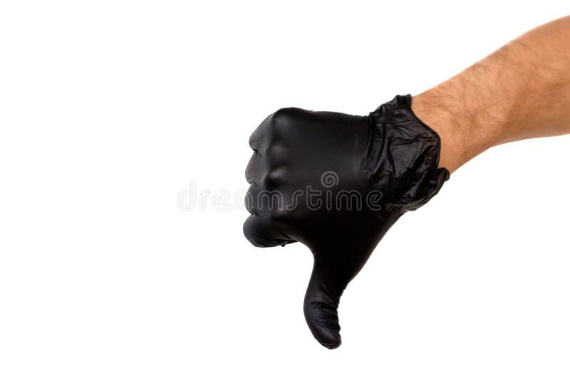 Aísle la mano del hombre en un guante de goma negro en un fondo blanco fotos de archivo libres de regalías