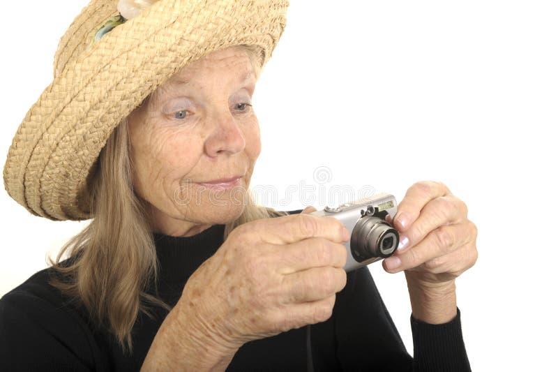 Aîné avec l'appareil-photo photographie stock libre de droits