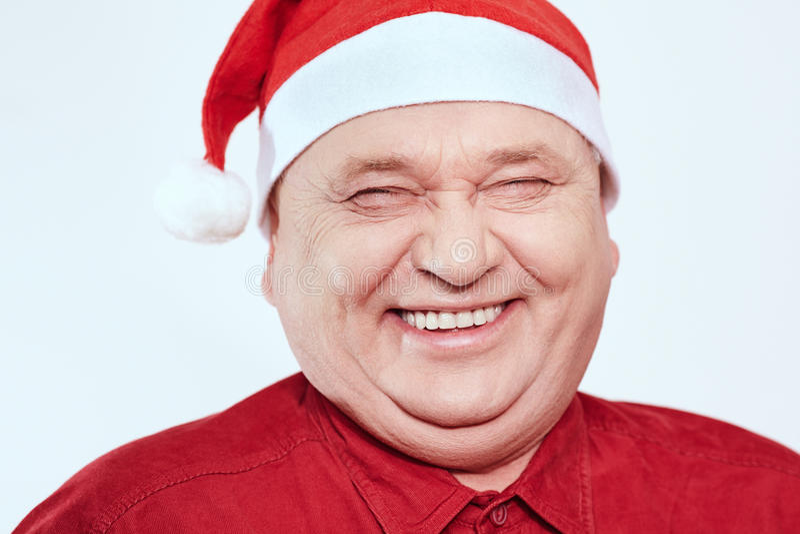 Aîné dans le chapeau de Santa Claus photo stock