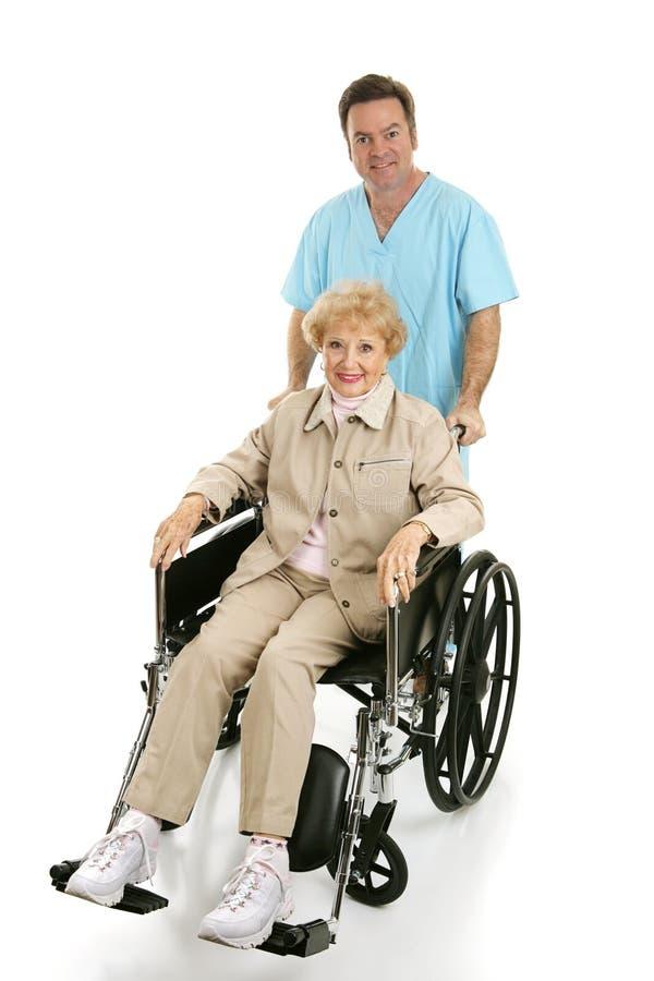 Aîné handicapé et infirmière photos libres de droits