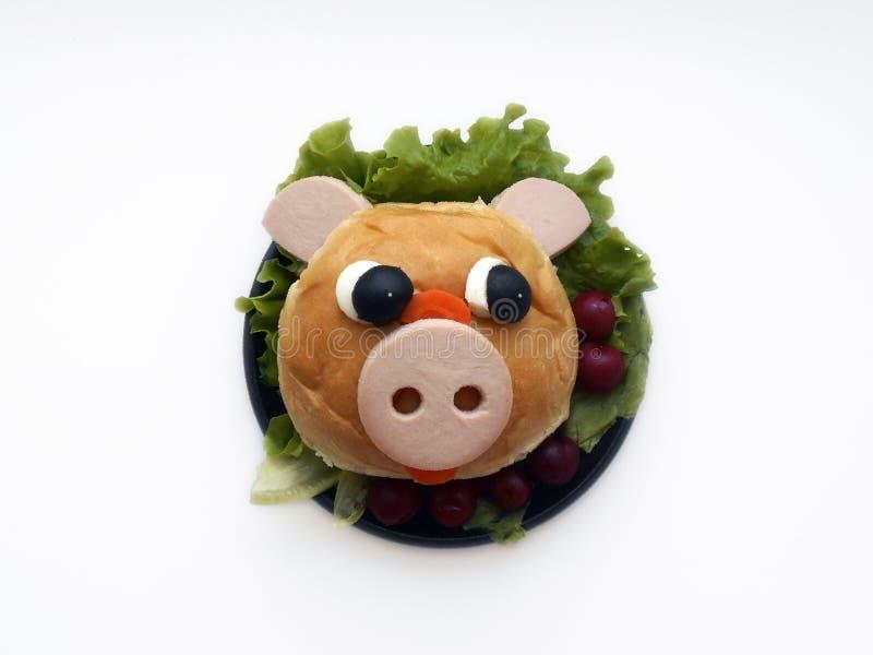 Año Nuevo, bocadillo de la Navidad bajo la forma de cabeza de un cerdo fotografía de archivo libre de regalías