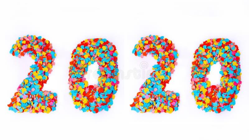 Año Nuevo - confeti numera 2020 - aislado en el fondo blanco foto de archivo