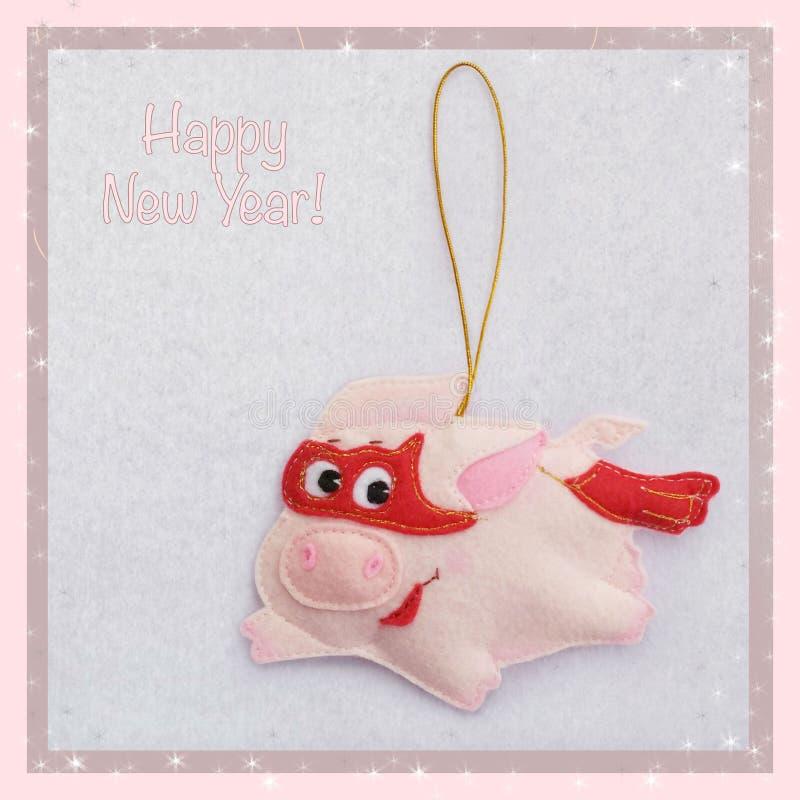 Año Nuevo Juguete suave hecho del fieltro el cerdo lindo Decoración del árbol de navidad El cochinillo está volando en un traje d foto de archivo