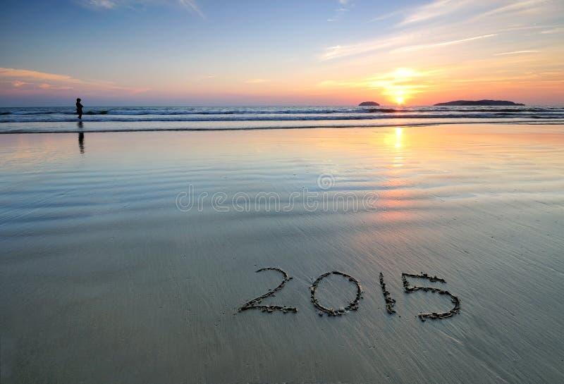 2015 Años Nuevos en la arena de la playa imagenes de archivo