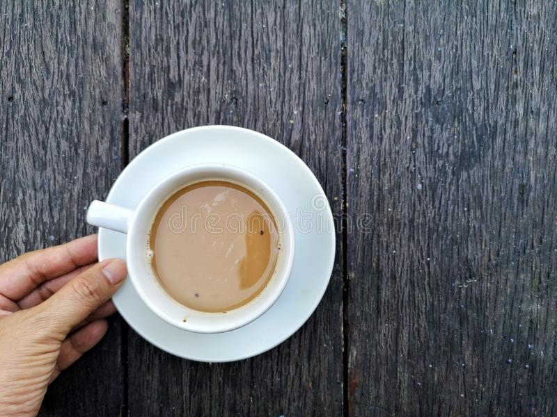 a cup of Coffee, white cup on wooden table. royalty free stock photography