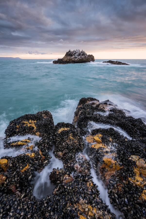 Free A Beautiful Moody Vertical Seascape Taken On A Stormy Cloudy Evening Stock Images - 178647364