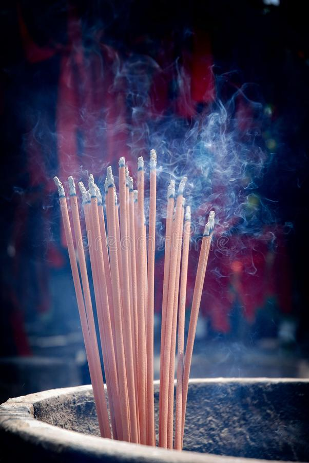 Free A Bunch Of Glowing Incense Sticks Royalty Free Stock Photography - 113083937