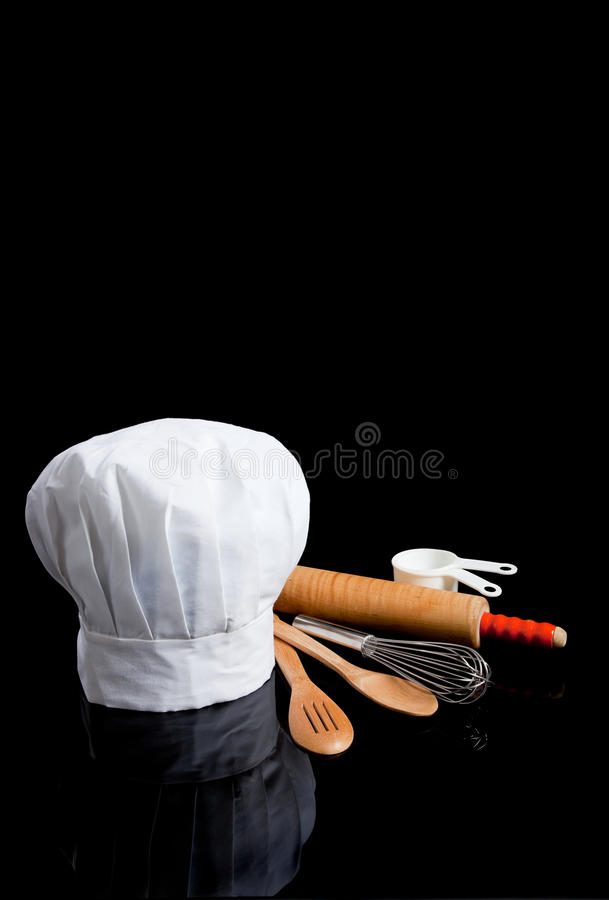 Free A Chef S Toque With Kitchen Utensils On Black Royalty Free Stock Images - 11595899