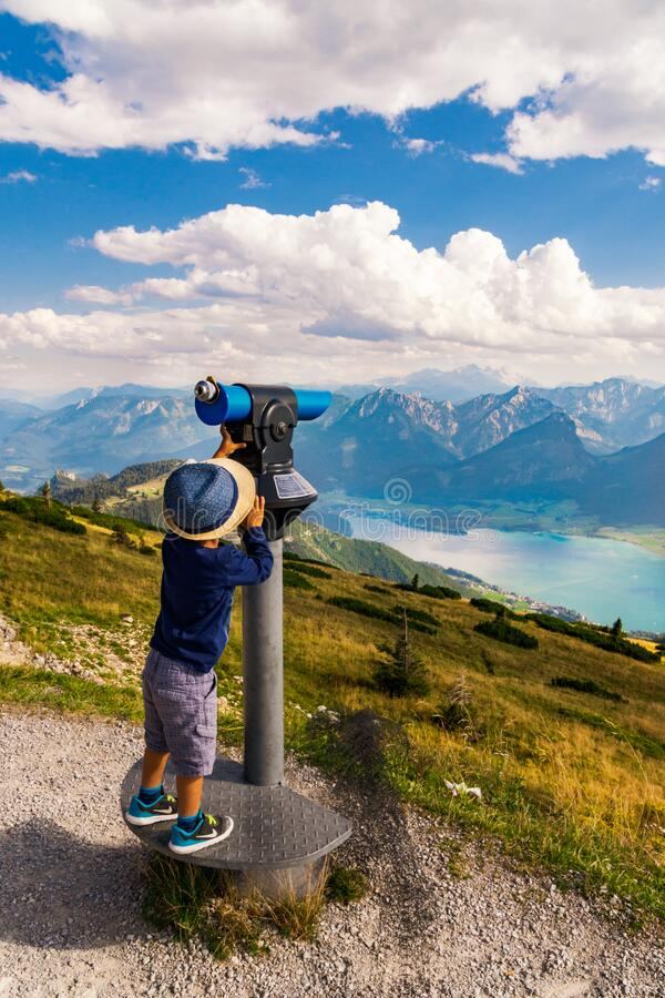 Free A Child Trying To See Alpine Ranges And Lake Landscape. Salzkammergut Austria Royalty Free Stock Photos - 207496458