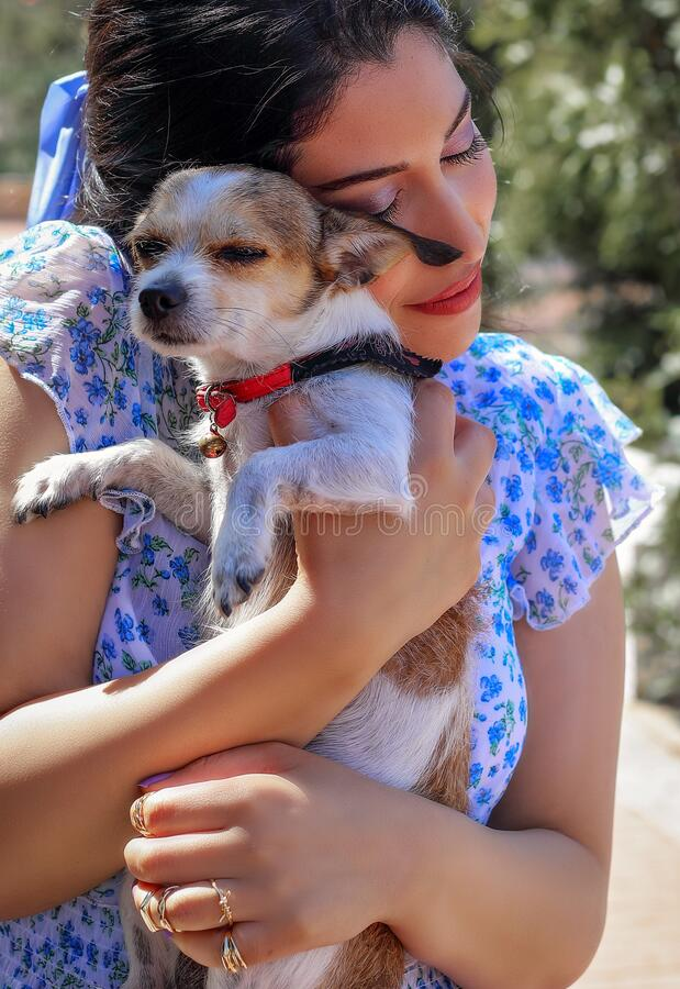 Free A Girl With Her Beloved Dog. Stock Image - 212353341