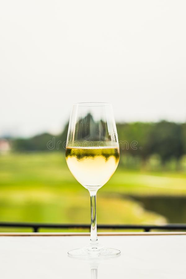 Free A Glass Of White Wine Chardonnay Sauvignon Blanc Riesling Wine Bar Royalty Free Stock Images - 144414959