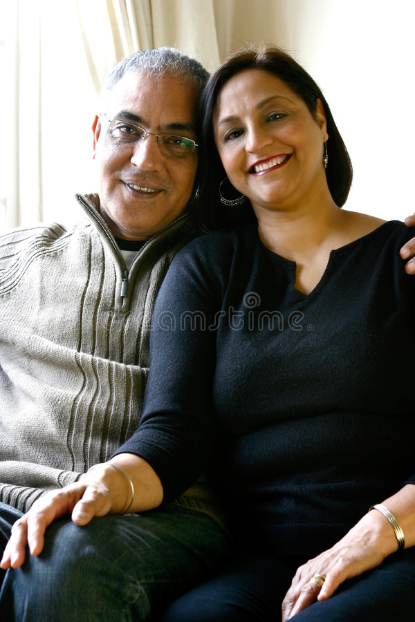 Free A Happily Married Asian Couple Relaxing Together Royalty Free Stock Photos - 1980508