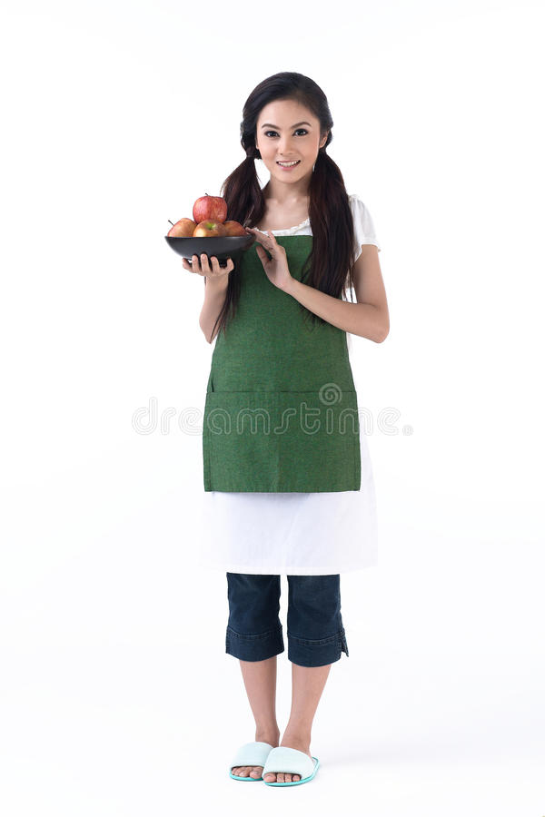 Free A Housewife Holding A Bowl Of Apples Stock Photography - 25590282