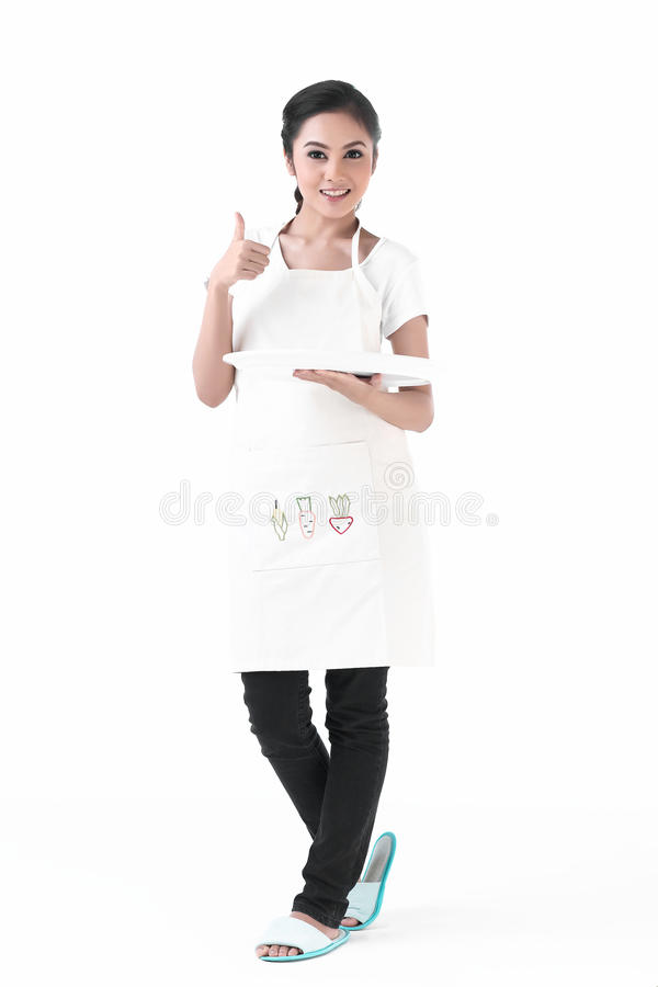 Free A Housewife Holding An Empty Plate Royalty Free Stock Photo - 25590165