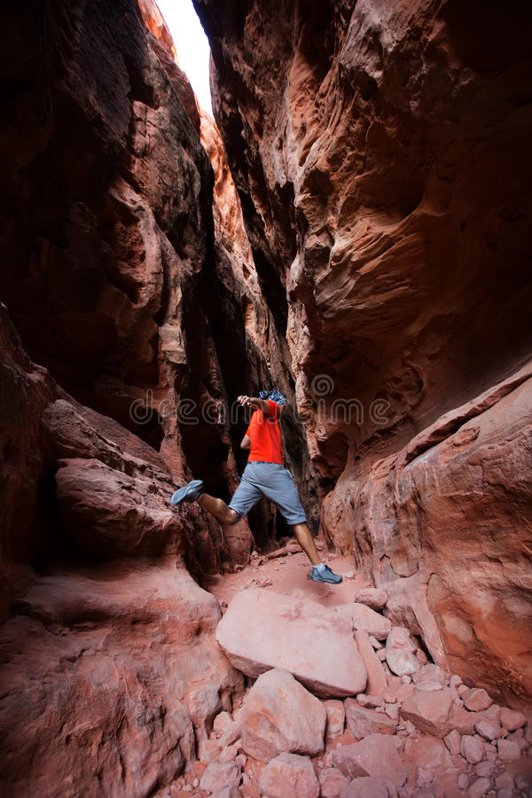 Free A Man Jumps From Stone In Jenny`s Canyon Within Snow Canyon Stock Photo - 97353550